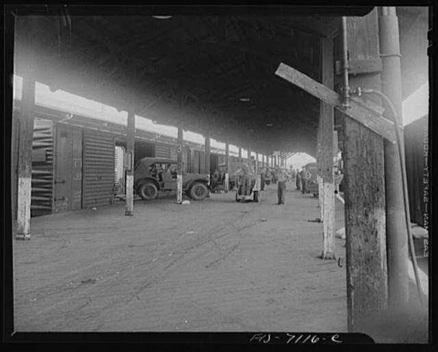 Chrysler Corporation. Dodge truck plant. Detroit, Michigan (vicinity). Loading Dodge Army trucks on freight cars