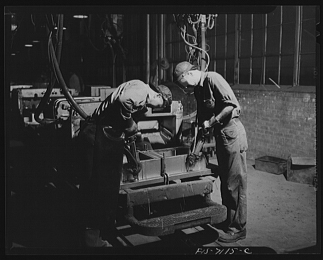 Chrysler Corporation. Dodge truck plant. Detroit, Michigan (vicinity). Spot-welding has supplanted bolts and rivets in many operations in the building of Dodge Army trucks. Here, two workers speed another Army vehicle along the production line