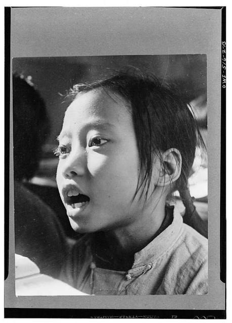 Chungking, China. A schoolgirl. In the municipality of Chungking there are 186 primary schools, 31 central and 155 public schools. 38,900 children in Chungking attend public school