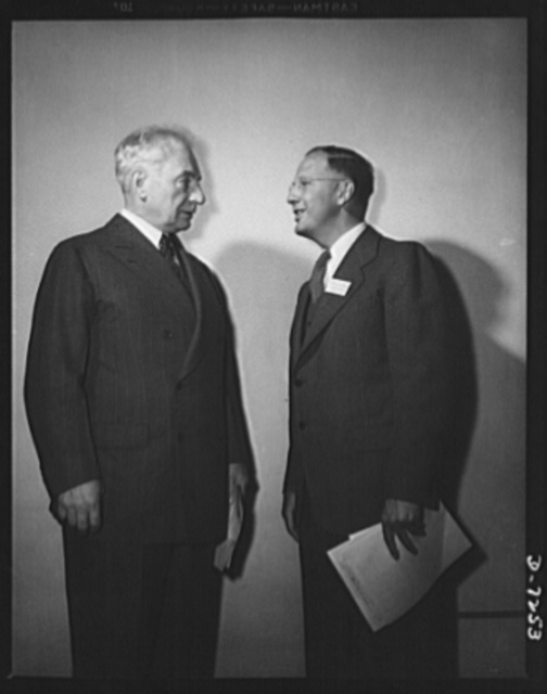 Citation winners. Citation winner, Clinton E. Hanna, (right) of the Westinghouse Electric and Manufacturing Company, East Pittsburgh, Pennsylvania, and William G. Marshall, Director of the War Production Drive, who presented the workers to President Roosevelt