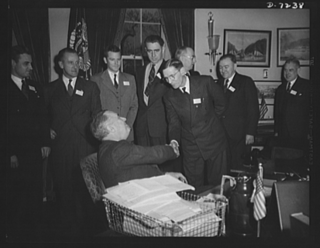Citation winners. President Roosevelt, congratulating Joseph H. Kautsky an employee of the Dodge Plant, Link-Belt Company if Indianapolis, Indiana after presenting him a citation