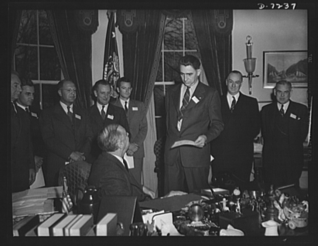 Citation winners. President Roosevelt, speaking with Daniel W. Mallett an employee at Mechanics Universal Joint Division, Borg-Warner Corporation, Rockford, Illinois, after presenting him a certificate