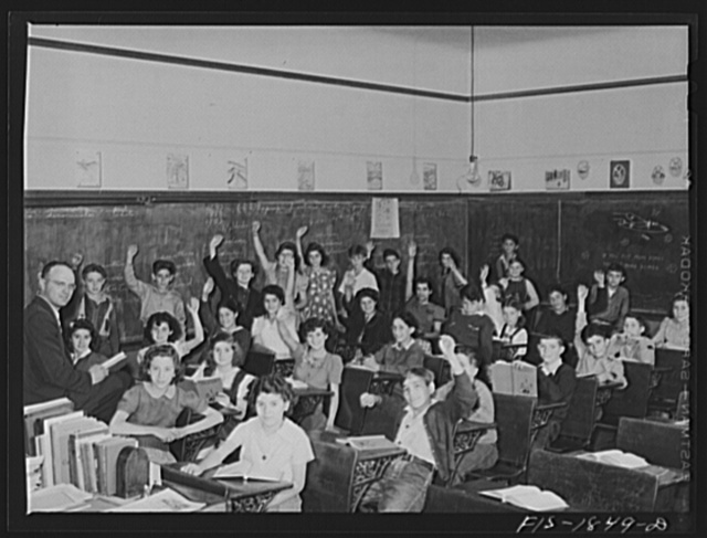 Classroom in a grade school of San Leandro, California. All children with their hands raised are of Portuguese descent, and are proud of it