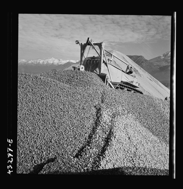 Columbia Steel Company at Geneva, Utah. Bulldozer handling gravel for concrete during the construction of a new steel mill which will make important additions to the vast amount of steel needed for the war effort