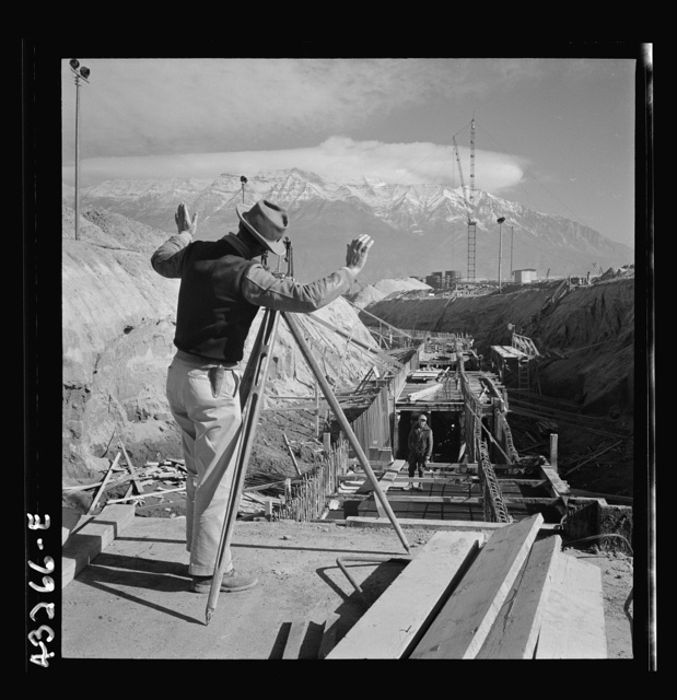 Columbia Steel Company at Geneva, Utah. Surveyor running lines for a water intake tunnel to serve a new steel mill under construction which will make important additions to the vast amount of steel needed for the war effort