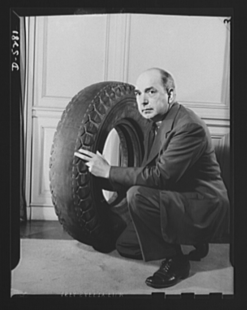 Conservation. Truck tires run 146,000 miles. No. 1. John L. Rogers, Director of the Division of Motor Transport, Office of Defense Transportation, displays a still-usable truck tire which has run 146,000 miles. The air pressure in its present condition