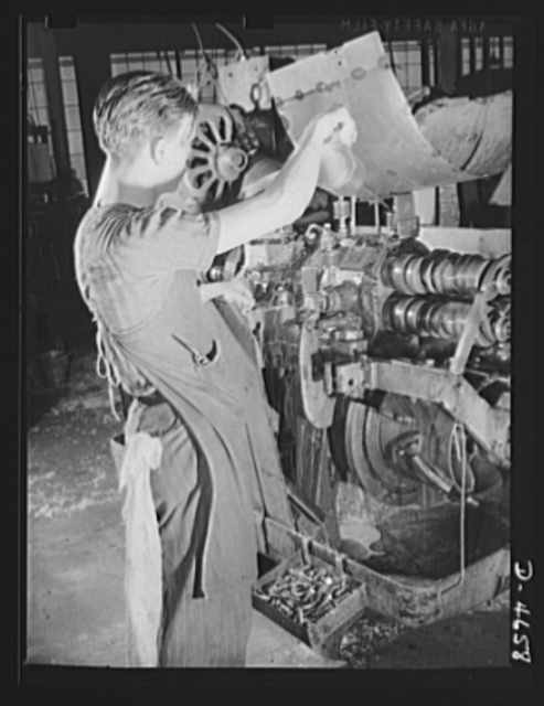 Conversion. Animal traps to armor-piercing bullet cores.  A screw-cutting machine in an Eastern animal trap factory just before it was converted from the making of machine bolts for the production of armor-piercing bullet cores