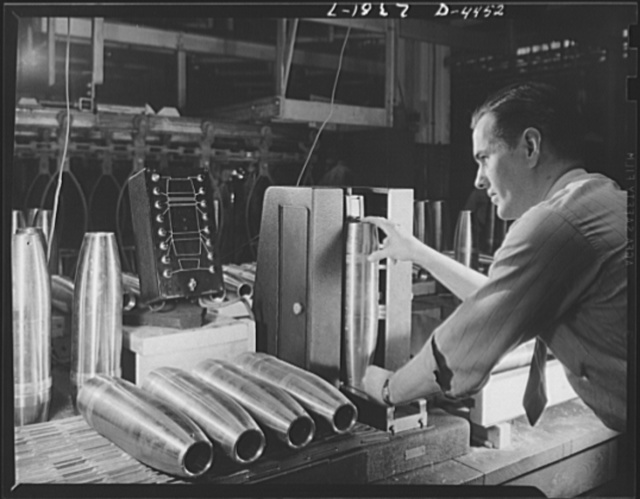 Conversion. Auto parts to artillery shells. Finished artillery shells are carefully gauged to ensure perfectly uniform ammunition for our fighting men. A converted Midwest auto plant is now producing these shells as efficiently as it turned out parts for automobiles