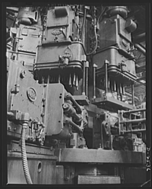 Conversion. Automobile industry. This special-purpose multiple drill formerly used in assembly of automobile parts, cannot readily be converted to war production. Unless some specific wartime use is found for it, the machine will be stored for the duration. The Plymouth Company, Chrysler Corporation, Detroit, Michigan