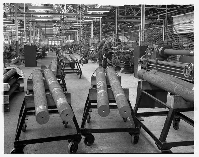 Conversion. Automobiles to 40 mm. anti-aircraft guns. 40 mm. anti-aircraft gun barrels for the U.S. Army are machined and finished in a former automobile plant. First they are cut to size and then their centers located. After that, they go down long machining lines where they are finished by mass production methods. Never before has any manufacturer attempted to make gun barrels of this size on a mass production basis. Chrysler Corporation, Highland Park, Detroit