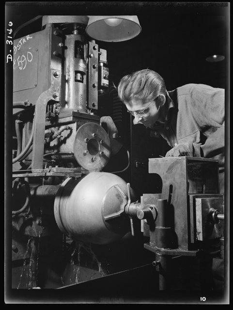 Conversion. Beverage containers to aviation oxygen cylinders. Four major welding operations are essential to the manufacture of shatterproof oxygen cylinders for high altitude flying. In the first, the circumferential straps are securely welded to the cylindrical portion to prevent tearing of the metal. The process is shown above, taken in the metal division of a large Eastern rubber factory. Firestone, Akron, Ohio