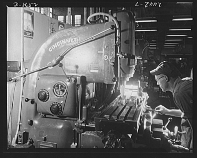 Conversion. Farm implements to gun parts. A milling operation is performed on a Bofors gun slide in a large Midwestern farm implement plant now converted to war production. The plant also makes marine steam cargo winches for the Maritime Commission
