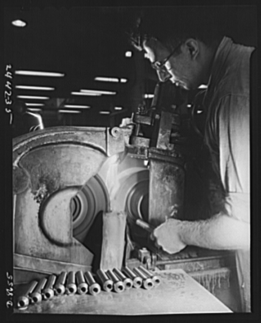 Conversion. Farm implements to gun parts. Prior to conversion to the production of military equipment, a centerless grinder was used by a Midwest farm implement manufacturer for grinding bearing pins for bell cranks of harvesting machines. This machine is now used in the production of 37 mm. shells