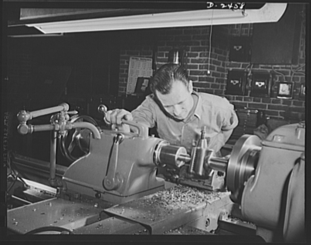 Conversion. Floor waxer plant. Through the skill and ingenuity of the entire personnel of this small Eastern manufacturing firm, machinery formerly used in production of floor waxers has been converted to production of war essentials. Pictured here is the night foreman employed by the company for fifteen years, who was instrumental in executing the changeover. Floorola Products Inc., York, Pennsylvania