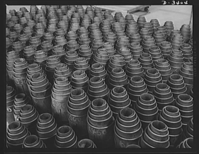 Conversion. Heaters to bogie wheels. Ready for final assembly, these bogie wheel springs have been stacked in the erstwhile warehouse of a Midwest heater factory. These springs are fitted into bogie wheel assemblies for Army M-4 tanks