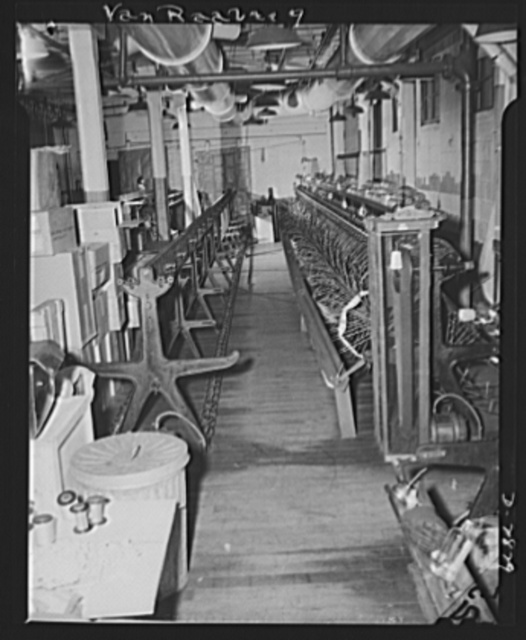 Conversion. Hosiery factory. Key to this picture is the little spool of silk thread on the machine at right. Instead of using Japanese silk to make women's stockings, this Eastern mill is converting many of its looms (see left) to production of mosquito netting to protect men fighting from insect bites. Van Raalte Company