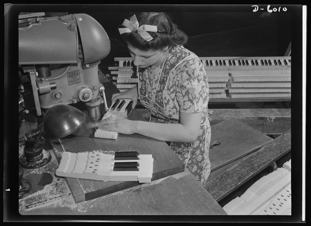 Conversion. Pianos to airplane motors. From piano keys to parts for trainer planes. Lorraine Avezzano, pictured at work in a Chicago piano factory prior to its conversion to war production. She uses the same boring machine today to process parts for Uncle Sam's trainer planes. Gulbransen Company