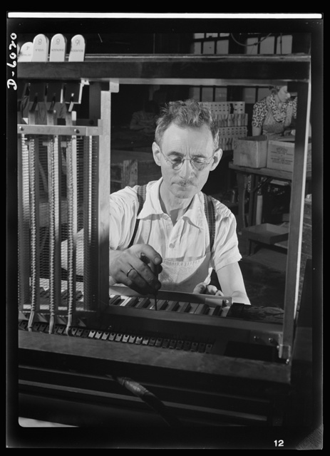 Conversion. Pianos to airplane motors. Norwegian-born Edward Groe has been employed by a Chicago piano factory since 1909, regulating keys of electric organs. With the plant's conversion to the production of trainer-plane motors, this master mechanic has discarded instruments of peace, such as this electric organ, for weapons of war. He now regulates pneumatic motors of trainer planes which are used for instruction of America's flying forces. Gulbransen Company