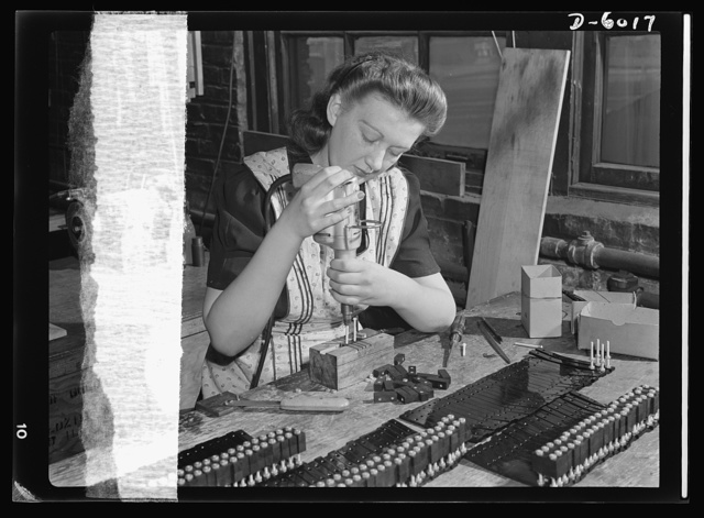 Conversion. Pianos to airplane motors. Operating an electric screwdriver, Bernice Strutz assembles parts for the pneumatic motors of Uncle Sam's trainer planes. Employed by a Chicago piano factory which is now converted to airplane motor production, Miss Strutz formerly operated a boring machine to assemble piano keyboards