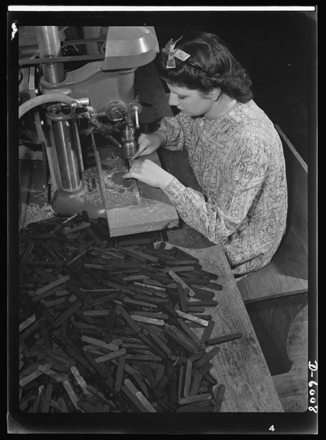 Conversion. Pianos to airplane motors. Prior to the conversion of a Chicago piano factory to the manufacture of parts for trainer planes, Lorraine Avezzano operated this boring machine to prepare piano keyboards for further assembly. Today she uses the same machine to process connecting rods for trainer-plane motors. More than 1,000 of these rods pass through her hands each day. Gulbransen Company