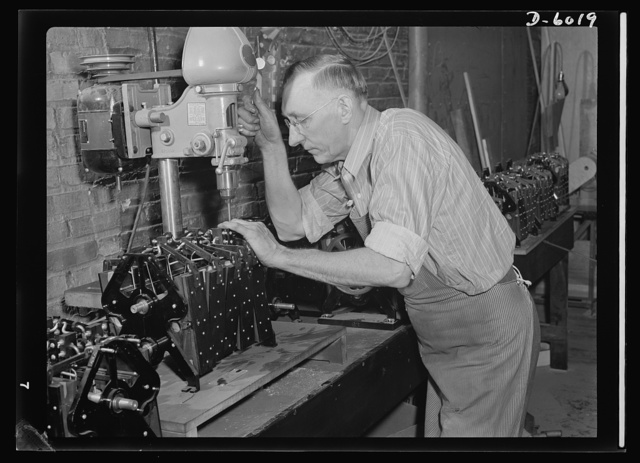 Conversion. Pianos to airplane motors. Using the same drill press which once assembled piano parts, this employee of a Chicago firm now installs gears in the pneumatic motors of trainer planes. The factory has stopped piano production for the duration and now produces trainer-plane motors for America's armed forces. Gulbransen Company