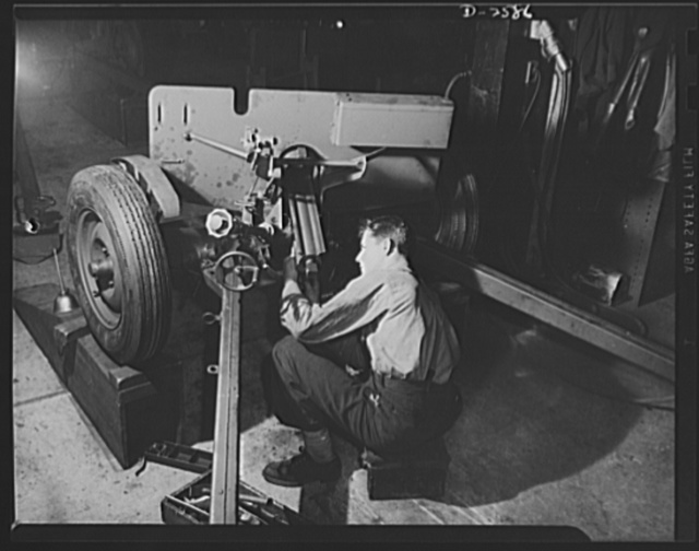 Conversion. Safe and lock company. Assembling weapons for Victory to be used by the armed forces. Gerald Smith, twenty-eight, assembles thirty-seven-millimeter gun mounts in a factory which formerly made safes and locks. York Safe and Lock Company, York, Pennsylvania