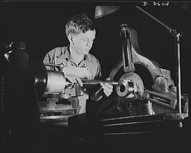 Conversion. Safe and lock company. Basing off the breech end of a thirty-seven-millimeter gun, this young worker is one of the millions of Americans hard at work behind the men behind the guns. Site of these operations is a factory which formerly made locks and safes, before its conversion to production of guns and gun mounts. York Safe and Lock Company, York, Pennsylvania