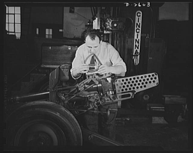 Conversion. Safe and lock company. Checking and inspection of thirty-seven-millimeter gun mounts for America's armed forces in a factory once devoted to manufacture of safes and locks for civilian use. York Safe and Lock Company, York, Pennsylvania