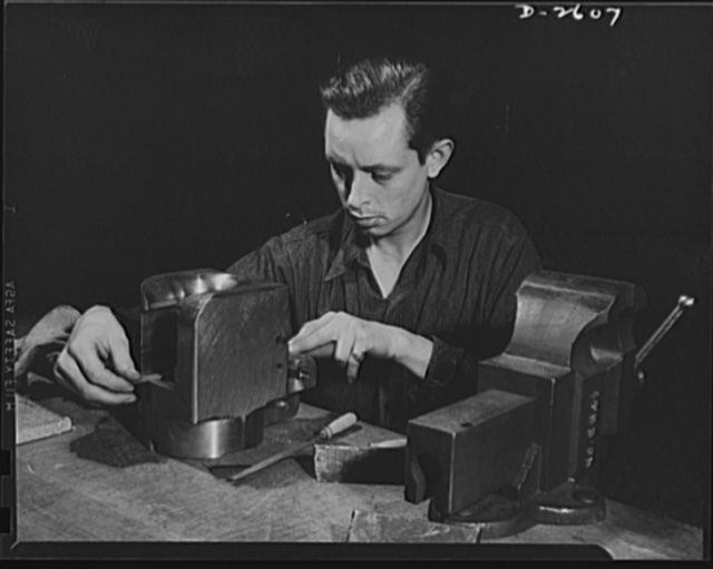 Conversion. Safe and lock company. Ex-auto mechanic pictured at work in ex-lock factory. Merril Darr, twenty-five, works on breech ring for a thirty-seven-millimeter gun. These guns and thirty-seven-millimeter gun mounts are now produced in a plant which formerly manufactured items for civilian use. York Safe and Lock Company, York, Pennsylvania