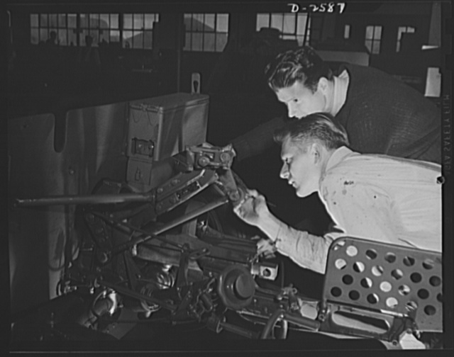 Conversion. Safe and lock company. Painting thirty-seven-millimeter gun mounts now produced in a factory which formerly made safes and locks for civilian use. York Safe and Lock Company, York, Pennsylvania