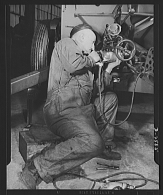Conversion. Safe and lock company. Sixteen years as an auto mechanic, this worker now assembles thirty-seven-millimeter gun mounts in a factory which formerly made safes and locks for civilian use. York Safe and Lock Company, York, Pennsylvania