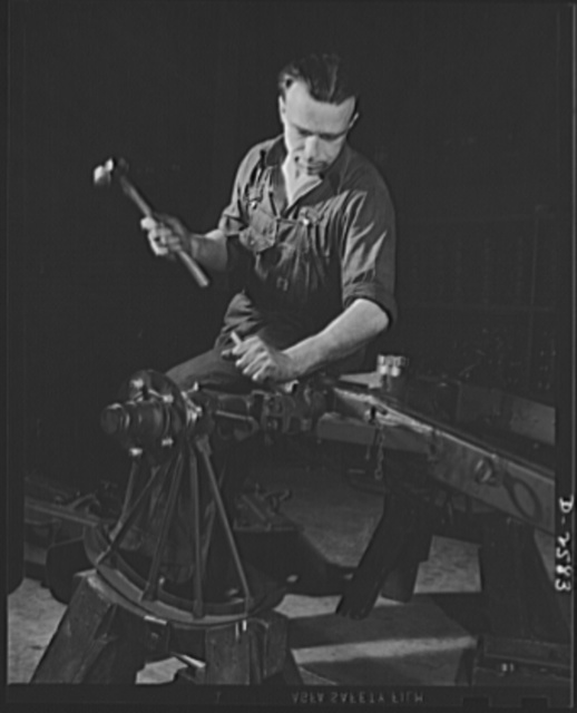 Conversion. Safe and lock company. This man and the factory he works in were both accustomed to a different kind of work in times of peace. A former silk weaver and loom repairman, this worker now assembles thirty-seven-millimeter gun mounts in a plant which made safe and locks before Pearl Harbor. York Safe and Lock Company, York, Pennsylvania