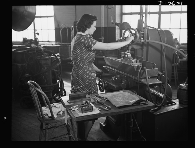 Conversion. Safety razor plant. From razor blades to V-blocks in few weeks! That's the story of Estelle Wilson, one of a New England razor company's many women employees who are now operating machines recently converted to production of war essentials. Gillette