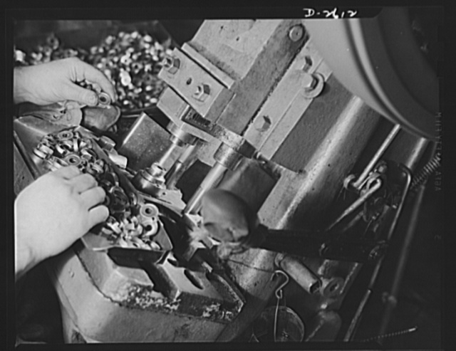 Conversion. Toy factory. Closeup of press in production of condenser caps to which it has been converted. Former production of this machine consisted of toys and movie projectors. Keystone