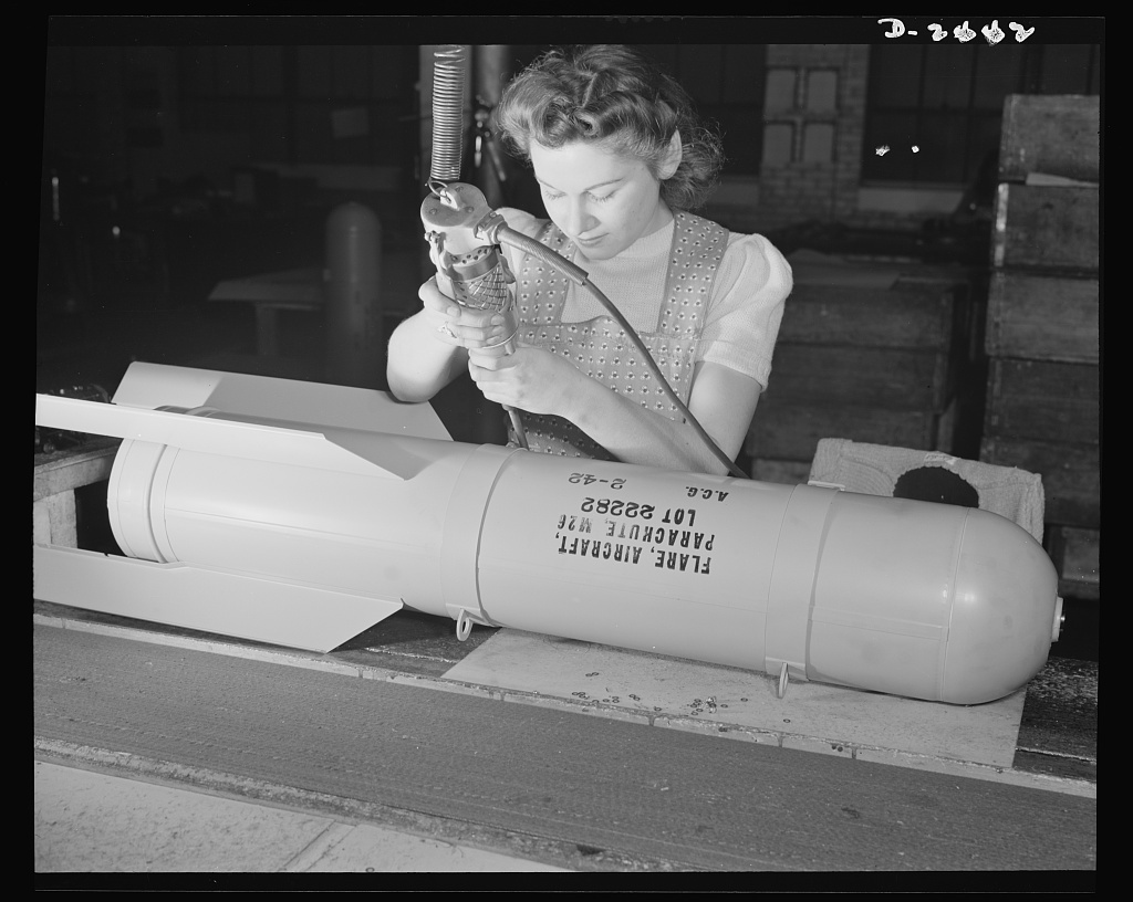 Conversion. Toy factory. From toy trains to parachute flare casings is the work history of Stephanie Cewe, whose skill with this electric screwdriver has been turned to the aid of Uncle Sam's war machine. Then Stephanie used to assemble toy locomotives, today, she uses the same screwdriver to assemble flare casings. A. C. Gilbert Company, New Haven, Connecticut