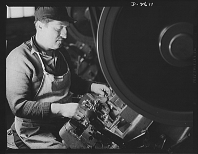 Conversion. Toy factory. This worker formerly produced toy wheels on this press; now his converted press adds to Uncle Sam's might in production of condenser caps for the Signal Corps, and of radio filter boxes for jeeps and tanks. Keystone