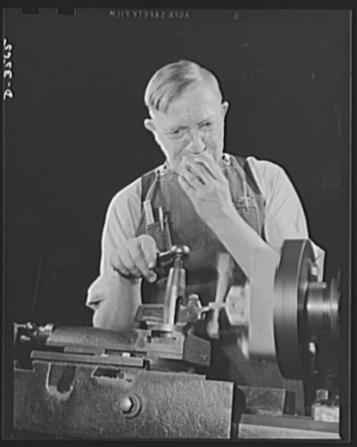 Conversion. Watch cases to war production. No time out for eating on an overtime job. Making bomb sights comes easy to him, for he has had long experience in precision work at a commercial Kentucky watch case factory now entirely on a war production basis. Wadsworth Watch Company, Louisville, Kentucky