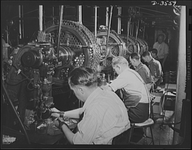 Conversion. Watch cases to war production. Squaring away for war Production. When the last batch of watch cases goes down the line of punch presses at a Kentucky factory, the trained operator will begin turning out compass cases, radio parts and small carbine machine gun parts for our armed forces. Note safety cords on all except second worker. He's die maker seting up a new job. Wadsworth Watch Company, Louisville, Kentucky