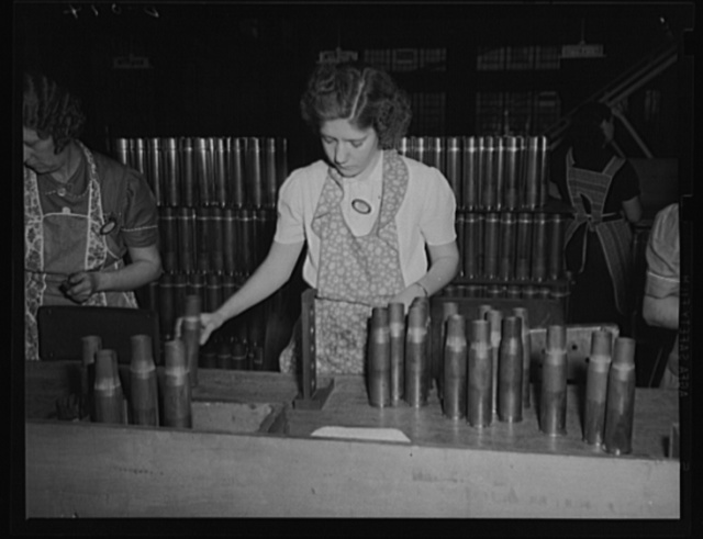 Critical eye on cartridge cases. Final inspection of 75 mm cases coming down the line in a steady stream at a large eastern arsenal for the Army's artillery