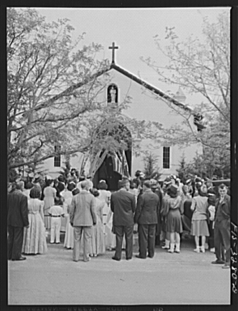 Crowd waits in front of church for the special mass to be over after which the Queen and her court and the parade will continue back to the I.D.E.S.I. hall for dinner, Novato, California