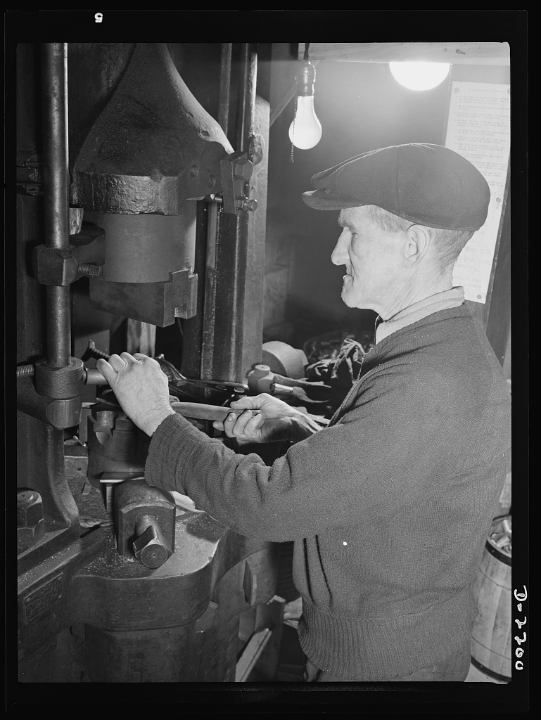 Dante Electric Company, Bantam, Connecticut. Ed Shaughnessy is one of the oldtimers in Bantam. For many years he worked as a plumber in the nearby town of Litchfield, living in Bantam. He has been with Dante Electric Company for twelve years now. Ed has a son in the Army, and is more than anxious to do what he can to speed production. Here he is working on the largest machine in the plant--a 150-ton drop press, used for forming heavy terminals