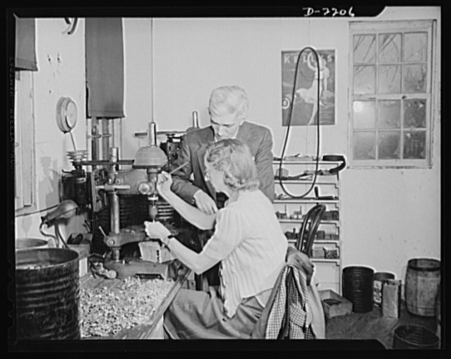 Dante Electric Company, Bantam, Connecticut. Mrs. Arthur Shaw is another resident of Bantam. Her husband is a private chauffeur in Litchfield. Mr. Dante is watching her operate a small drill press. Mrs. Shaw has volunteered to serve as one of Bantam's air raid watchers, puts in several early morning hours at the local observation post before reporting to work in the morning