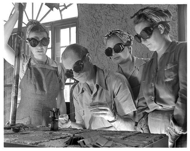 De Land pool. Aircraft construction class. Clyde Williams, instructor in the Volusia County, Florida Vocational School, believes women make just as good welders as men. He is shown here with a new class starting in aircraft welding, part of the training program of the De Land pool to provide workers for war production. Left to right are Jane Parker, whose husband already is a war welder and plans to volunteer for the Navy when she can take his place; Kathleen Nowlin, stenographer, an English girl who is a naturalized American citizen; and Sybil Meyers, a housewife