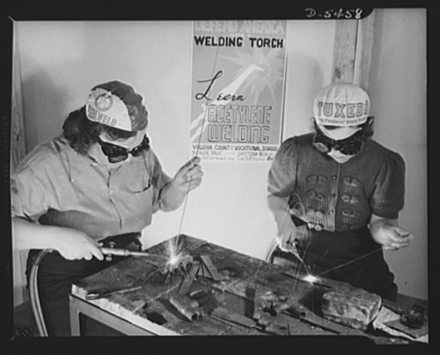 De Land pool. Aircraft construction class. Women of De Land, Florida went to school with their men-folk to learn welding and aircraft fabric work in preparation for the De Land million-dollar war contract. Above Mrs. Ruby Shie, left, former nurse with a husband and one child, and Mrs. William Tomlinson, former bookkeeper and secretary with one child, are getting ready for the time when they will take their place on the plant assembly line to turn out fighter planes for the Air Corps