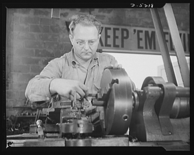 "De Land pool. Carr's Machine Shop. L.F. Quinton used to be a radio sound engineer with a home workshop where he acquired skill in working to close tolerances, making model racing cars. Now he's using that ""know-how"" making precision worm gears for the De Land, Florida pool"