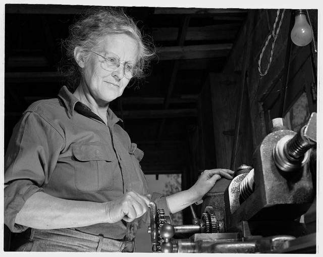 De Land pool. La Roe shop. Mrs. Earl La Roe of Eustis, Florida, a grandmother with two sons in the army, doing her daily shift in the family's garage workshop. She is cutting worm gears needed for the army aircraft equipment made by the De Land, Florida industrial pool