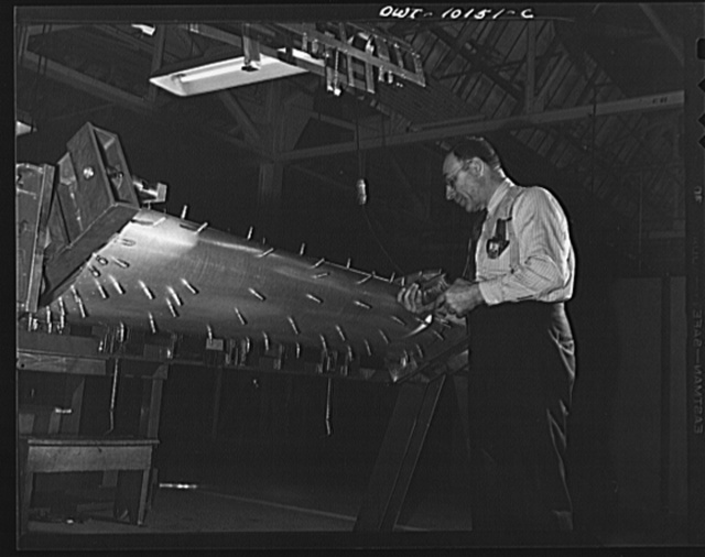 De Soto bomber plant. Detroit, Michigan. Cleco clamps holding various parts together in a sub-assembly fixture until they are all riveted