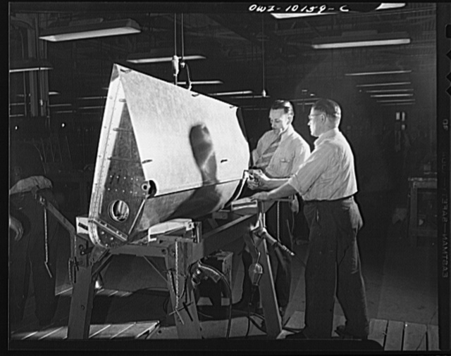 De Soto bomber plant, Detroit, Michigan. Clecoing skin to the ribs of an inboard flap