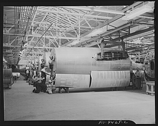 De Soto bomber plant. Detroit, Michigan. General view showing assembly line of mid-section of B-26 bomber. Picture shows how bomber parts are suspended by overhead conveyor