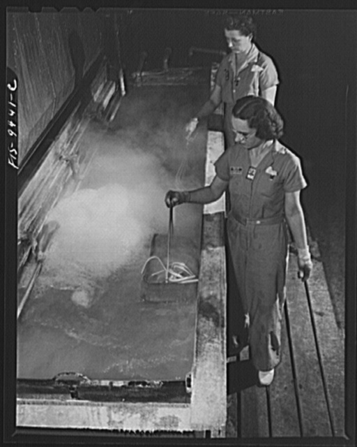 De Soto bomber plant. Detroit, Michigan. Girls dipping magnesium tubing in hot clean bath to get rid of grease and acid
